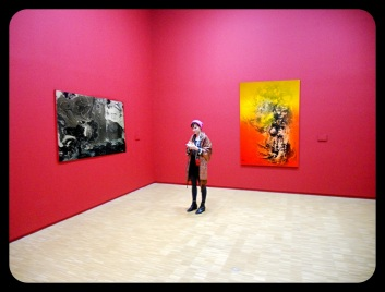 "Lala in front of two of her pieces. Left, ""My Blackberry Doesn't Work Here."" And right, ""The U Très Fermée."""