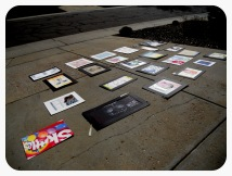 Lala's work displayed on the driveway.