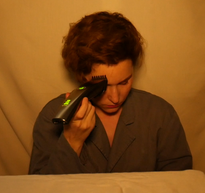 "Lala Drona photo from art performance shaving video ""Willing"""