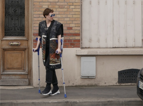 Lala Drona spotted in Paris on crutches wearing winter 2018 OAMC and Nike Ambush collaboration sneakers and Gentle Monsters sunglasses